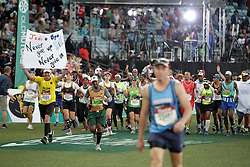 10062018 (Durban) an athletes pass the finnish line at the Mosses Mabhida stadium venue during the Comrades Marathon on Sunday as Bong'musa Mthembu and Ann Ashworth ensured that the coveted titles remained on these shores.<br /> Picture: Motshwari Mofokeng/African News Agency/ANA