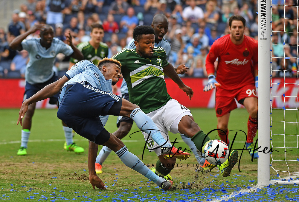 Portland Timbers defender Jermaine Taylor (4) blocks the shot of Sporting KC defender Saad Abdul-Salaam (17) during the second half at Children's Mercy Park.