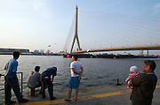 Chao Phraya river, Rama XIII Bridge. Dragon boat race to celebrate King Bumiphol Adulyadej's Birthday on December 5.