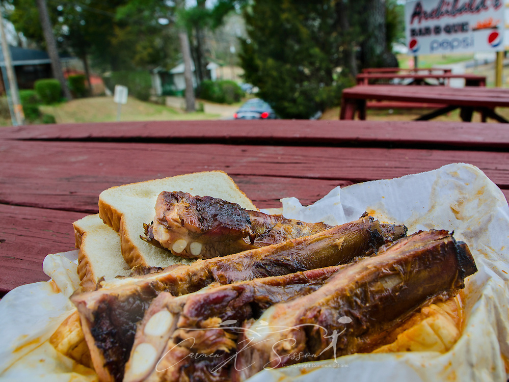 A plate of barbecued spare ribs sits on a picnic table outside Archibald's Bar B.Q. in Northport, Ala., March 15, 2014. The restaurant, established in 1962, is a local favorite. (Photo by Carmen K. Sisson/Cloudybright)