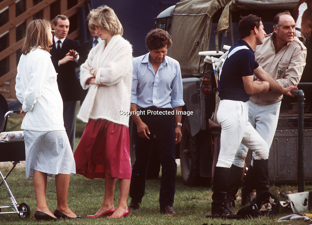 Diana, the Princess of Wales, pregnant with Prince Harry, chats while at a polo event with Prince Charles as bodyguard Barry Mannakee (second from left) looks on in this June1984 file photo in Windsor, England.  A video tape released in the US of Diana speaking in 1992 shows her stating she wanted to run away from Prince Charles and live with  Mannakee. Diana also expresses fears Mannakee was murdered when he died in a motorcycle accident in 1987.  (Photo by Anwar Hussein)