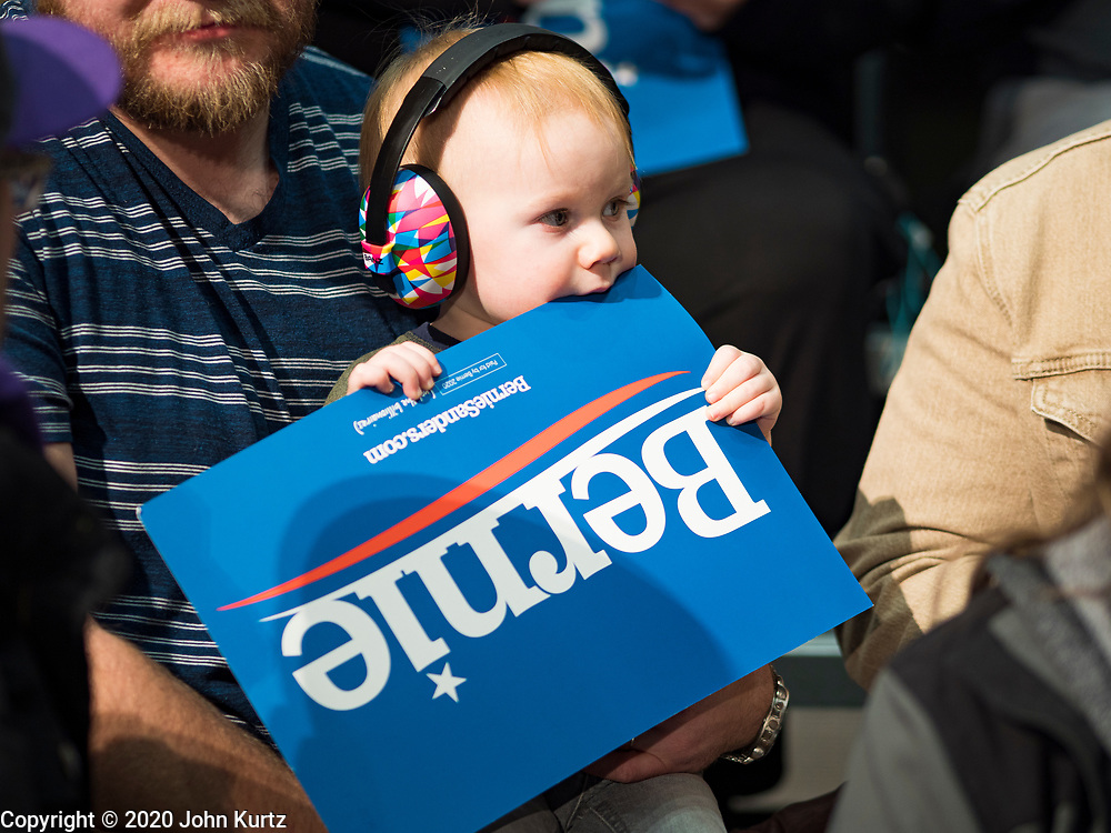 02 MARCH 2020 - ST. PAUL, MINNESOTA: ODIN SABOTTA, 1 year old, from Rochester, MN, wore earfuffs because of the noise at a Bernie Sanders Get Out the Vote rally in the RiverCentre in St. Paul. More than 8,400 people attended the rally. Minnesota is a Super Tuesday state this year and Minnesotans will go to the polls Tuesday. Minnesota Sen. Amy Klobuchar was expected to win her home state, but she dropped out early Monday, March 2.        PHOTO BY JACK KURTZ