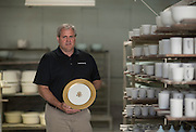 Andrew Pickard Morgan, CEO of Pickard China holds an official White House charger plate in Antioch Thursday morning. Pickard China recently made a full set of china for the White House which was used during the recent state dinner with Japanese leaders. The 320 person set included 12 total pieces each. The cost was $362,000.<br />