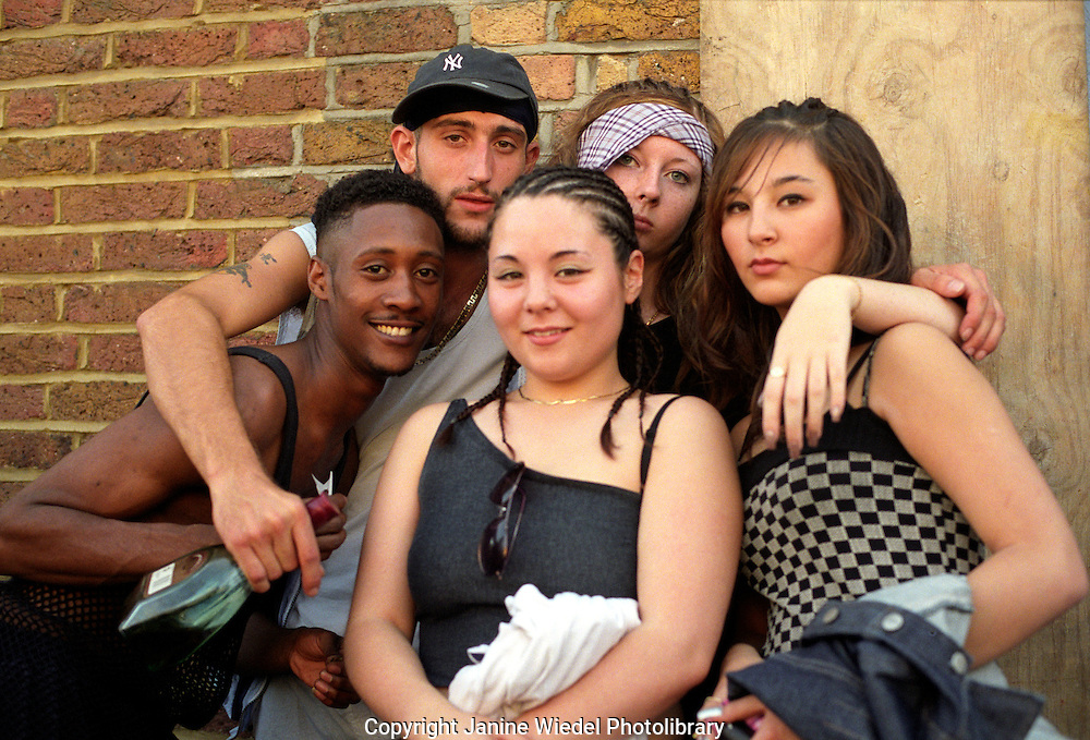 Group of young girls and boys hanging around streets in Nottinghill Gate , London.