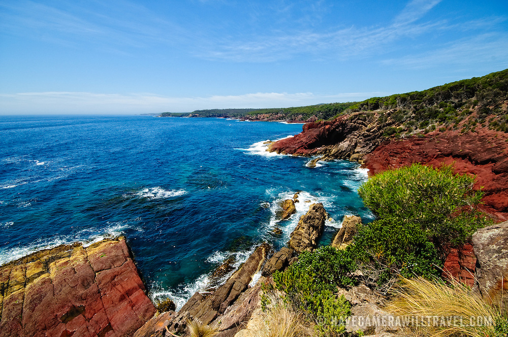 At Twofold Bay in Ben Boyd National Park near Eden on the NSW Sapphire Coast, sandstone and red siltstone create folds in the rock from geological forces.