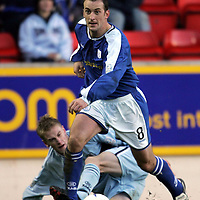 St Johnstone v Raith Rovers..26.12.04<br />St Johnstone number 8 Paul Sheerin pulls away from a tackle by Raith's number 8 Bruce Raffell<br /><br />Picture by Graeme Hart.<br />Copyright Perthshire Picture Agency<br />Tel: 01738 623350  Mobile: 07990 594431