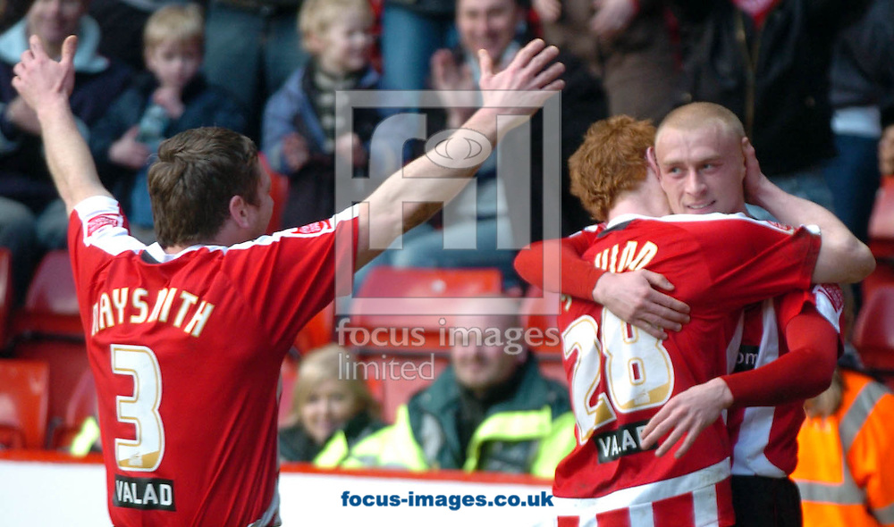 Sheffield - Sunday, March 1st, 2009:  Sheffield United's Gary Naysmith and Stephen Quinn help David Cotterill celebrate his match winning penalty for Sheffield against Birmingham City during the Coca Cola Championship match at Bramall Lane, Sheffield. (Pic by John Rushworth/Focus Images)
