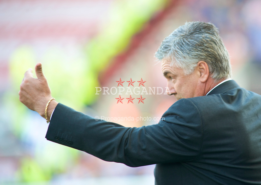 STOKE, ENGLAND - Saturday, September 12, 2009: Chelsea's Manager Carlo Ancelotti gives out his orders against Stoke City during the Premiership match at the Britannia Stadium. (Pic by Gareth Davies/Propaganda)