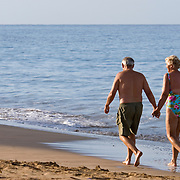 Mature couple walking on the beach in Maui, Hawaii
