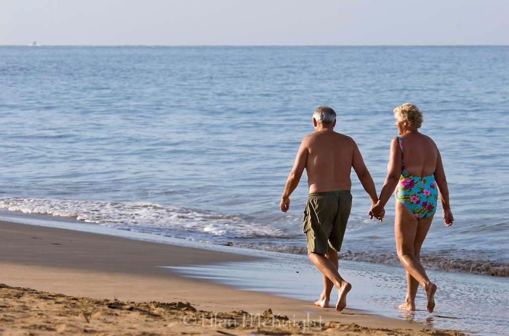 Mature couple walking on the beach in Maui, Hawaii