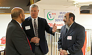 Ibrahim Shehata (left), of Cedar Falls, and Ayman Amer (right), of Cedar Rapids, talk with Marion Mayor Allen 'Snooks' Bouska (center) at the celebration of the first anniversary of the Egyptian revolution for democracy at the Muslim American Society, 2121 North Towne Lane NE in Cedar Rapids on Wednesday evening, January 25, 2012. The evening's activities included various speakers, a video documentary about the revolution, and a meal. (Stephen Mally/Freelance)