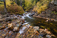 Big Cottonwood Creek flows through the rocky canyon during Fall in Utah's Wasatch Mountains.