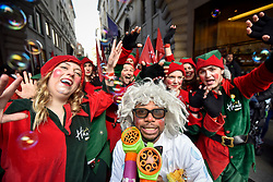 © Licensed to London News Pictures. 19/11/2017. London, UK.  Elves and popular toy characters prepare to take part in Hamleys' annual Toy Parade in Regent Street along with marching bands and toy vehicles.  Photo credit: Stephen Chung/LNP