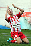 Accrington Stanley midfielder Sean McConville slides to celebrate his opener during the The FA Cup match between Accrington Stanley and York City at the Fraser Eagle Stadium, Accrington, England on 7 November 2015. Photo by Pete Burns.