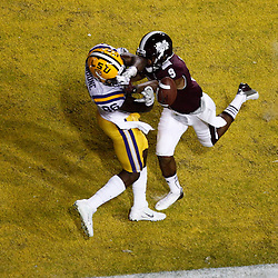 November 10, 2012; Baton Rouge, LA, USA;  Mississippi State Bulldogs defensive back Darius Slay (9) breaks up a pass to LSU Tigers wide receiver Kadron Boone (86) during the second half of a game at Tiger Stadium.  LSU defeated Mississippi State 37-17. Mandatory Credit: Derick E. Hingle-US PRESSWIRE