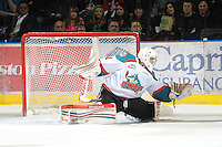 KELOWNA, CANADA, FEBRUARY 17: Adam Brown #1 of the Kelowna Rockets makes a save against the Calgary Hitmen at the Kelowna Rockets on February 17, 2012 at Prospera Place in Kelowna, British Columbia, Canada (Photo by Marissa Baecker/Shoot the Breeze) *** Local Caption ***