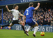 Everton defender Leighton Baines gets a crucial slide tackle in on Chelsea defender Branislav Ivanovic during the Barclays Premier League match between Chelsea and Everton at Stamford Bridge, London, England on 16 January 2016. Photo by Andy Walter.