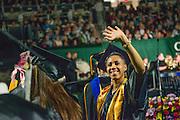 Jasmine Craig waves to supporters dat undergraduate commencement. Photo by Ben Siegel