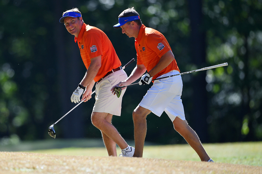 Dan Mullen and Judd Davis walk to their cart during the Chick-fil-A Peach Bowl Challenge at the Oconee Golf Course at Reynolds Plantation, Sunday, May 1, 2018, in Greensboro, Georgia. (Dale Zanine via Abell Images for Chick-fil-A Peach Bowl Challenge)