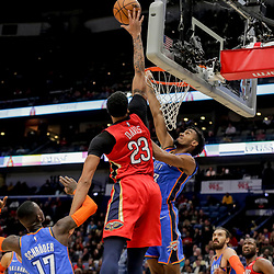 Dec 12, 2018; New Orleans, LA, USA; New Orleans Pelicans forward Anthony Davis (23) dunks over Oklahoma City Thunder forward Nerlens Noel (3) and guard Dennis Schroder (17) during the second half at the Smoothie King Center. Mandatory Credit: Derick E. Hingle-USA TODAY Sports