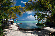 An infinity pool facing the sea at the Lux Le Morne Hotel on the Le Morne Peninsula in south west Mauritius.  The Indian Ocean