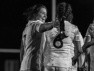 Poppy Leitch puts her arm around Sally Stott as the team celebrate a try, Army Women v U20 England Women at the Army Rugby Stadium, Aldershot, England, on 16th February 2017. Final score 15-38.