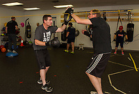 "Mike O'Neill and Don Clarke work on sparring drills during their ""Rock Steady Boxing"" class at the Downtown Gym on Thursday evening.  (Karen Bobotas/for the Laconia Daily Sun)"