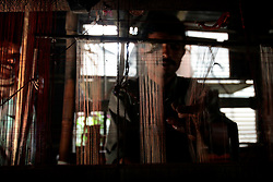 BANGLADESH SIRAJGANJ SAJANTULI 1FEB07 - A weaver toils at his handloom in a rural sweatshop containing 60 looms in rural Sirajganj. Records of an indigenous weaving industry based on handlooms producing cotton fabrics date back to the 13th century in this area...jre/Photo by Jiri Rezac..© Jiri Rezac 2007..Contact: +44 (0) 7050 110 417.Mobile:  +44 (0) 7801 337 683.Office:  +44 (0) 20 8968 9635..Email:   jiri@jirirezac.com.Web:    www.jirirezac.com..© All images Jiri Rezac 2007 - All rights reserved.