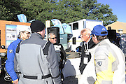 Jim Hyde (at right with glasses) talking to riders at 2010 Rawhyde Adventure Rider Challenge.