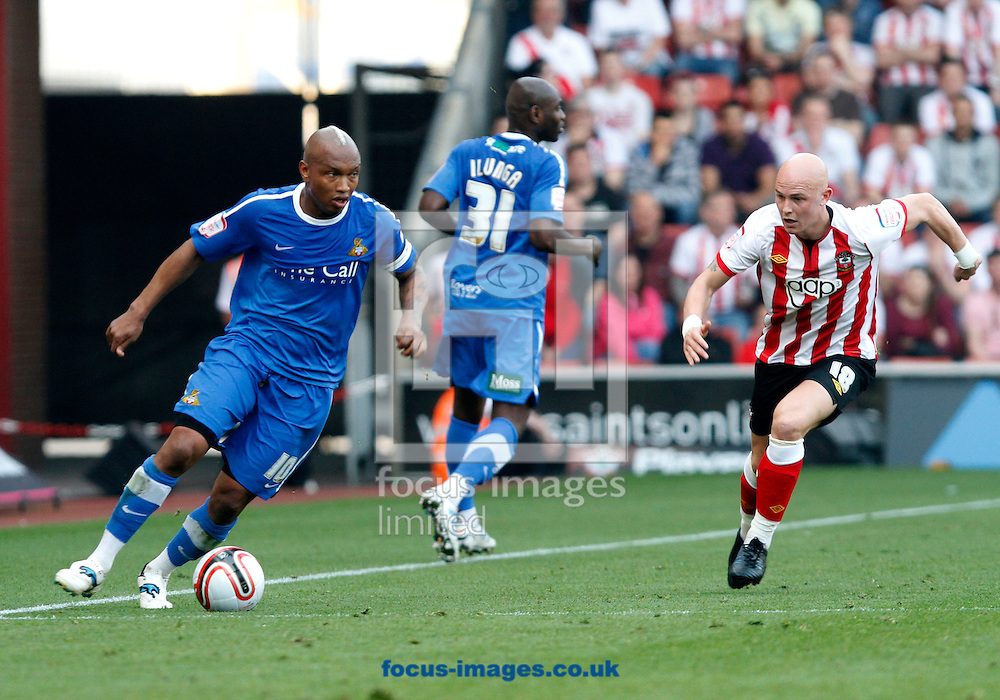 Picture by Daniel Chesterton/Focus Images Ltd. 07966 018899.24/03/12.Richard Chaplow of Southampton and El-Hadji Diouf of Doncaster Rovers during the Npower Championship match at St Mary's stadium, Southampton.
