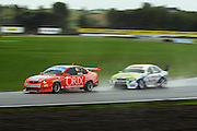John McIntyre (right) creeps up on Paul Manuell in the Reverse Grid race.<br /> BNT V8s Championship at Manfeild Autocourse, Feilding. Sunday 1 March 2009. Photo: Dave Lintott/PHOTOSPORT