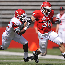 Apr 24, 2010; Piscataway, NJ, USA; White cornerback Duron Harmon (32) pushes Scarlet running back Joe Martinek (38) out of bounds during Rutgers Scarlet and White intersquad NCAA football scrimmage at Rutgers Stadium. The Scarlet squad defeated the White, 16-7.