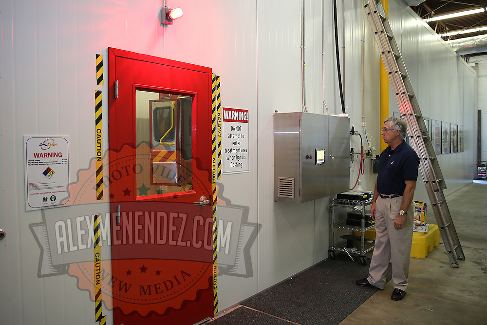 AeroClave founder Dr. Ronald Brown decontaminates a rescue vehicle at his office in Winter Park, Florida on Friday, Oct. 10, 2014. Viruses with similar characteristics to Ebola have been tested with positive results that show the pathogens can be erased. The Winter Park Fire/Rescue organization now has three ambulances equipped with self contained, built-in decontamination units – coming in the wake of an international Ebola virus scare. The units feature pressurized pumps, which release a decontamination mist inside the patient area of the ambulance. It takes about 15 minutes for the mist to cover all the surface area inside and break the chain of infection.  (AP Photo/Alex Menendez)