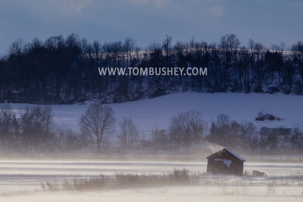 GOSHEN - Strongs winds blow snow across farm fields on Jan. 30, 2015.