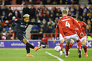 Charlton Athletic striker Lyle Taylor  shoots and scores a goal during the EFL Sky Bet Championship match between Nottingham Forest and Charlton Athletic at the City Ground, Nottingham, England on 11 February 2020.
