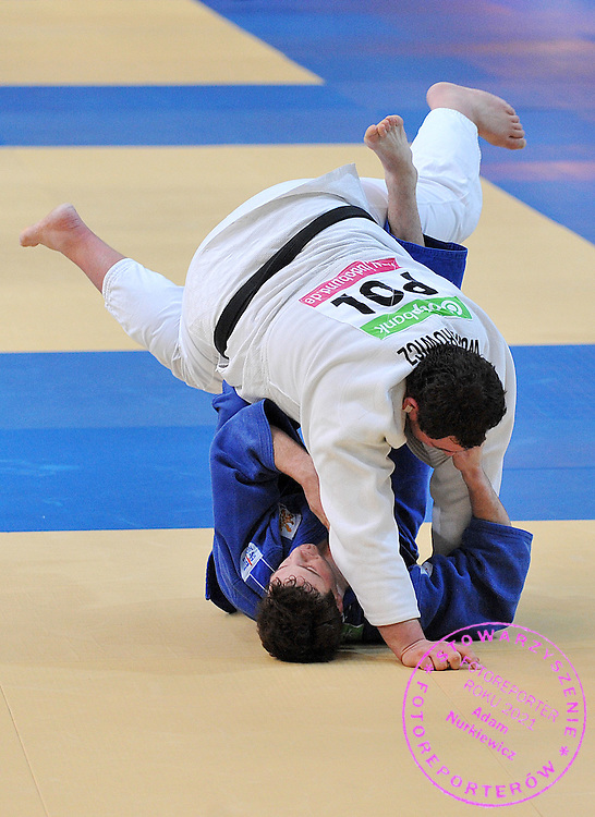 (WHITE) JANUSZ WOJNAROWICZ (POLAND) & (BLUE) LUUK VERBIJ (NETHERLANDS) DURING +100 KG WEIGHT CATEGORY FIGHT ON JUDO WORLD CUP MEN AT ARENA URSYNOW HALL IN WARSAW, POLAND...WARSAW , POLAND , MARCH 01, 2009..( PHOTO BY ADAM NURKIEWICZ / MEDIASPORT )..PICTURE ALSO AVAIBLE IN RAW OR TIFF FORMAT ON SPECIAL REQUEST.