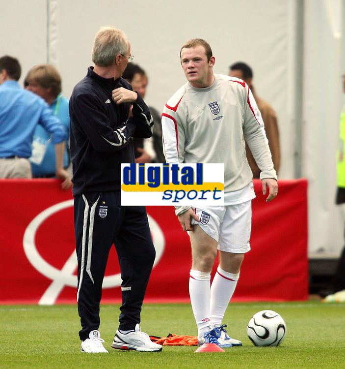 Photo: Chris Ratcliffe.<br />England training session. 06/06/2006.<br />Wayne Rooney chats with Sven Goran Eriksson about his chance of being fit.