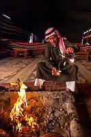 Bedouin man serving coffee in his tent, Wadi Rum, Jordan.