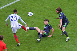 LENS, FRANCE - Thursday, June 16, 2016: Wales' James Chester and Joe Allen in action against England's Dele Alli during the UEFA Euro 2016 Championship Group B match at the Stade Bollaert-Delelis. (Pic by Paul Greenwood/Propaganda)