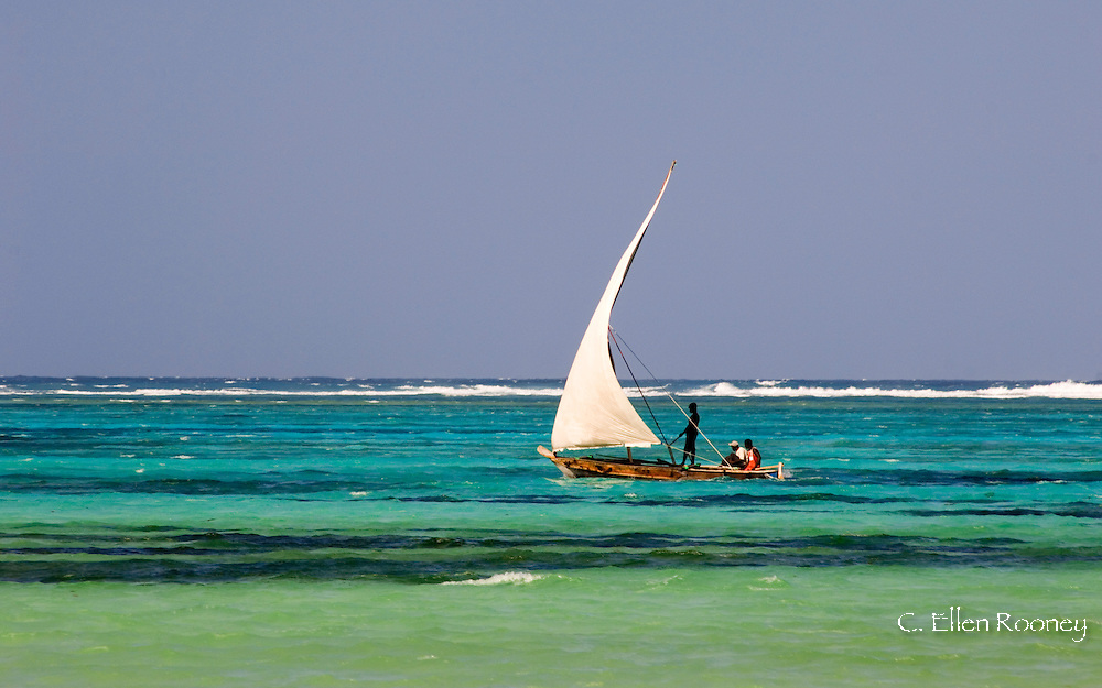 A traditional wooden sailing dhow near Mnemba Island, Zanzibar, Tanzania