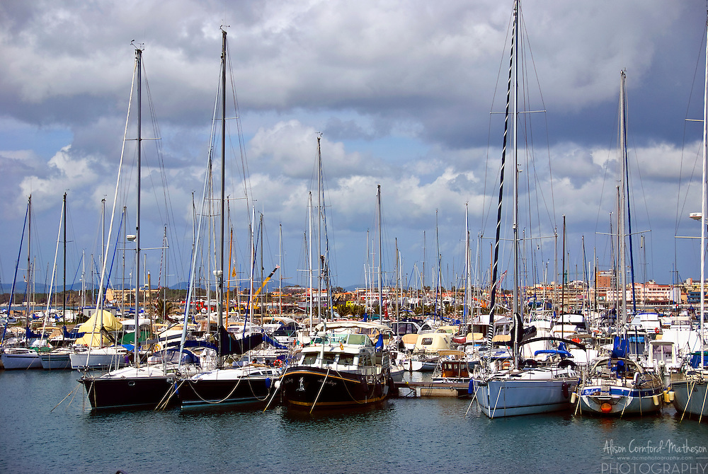 Sailboats in the harbour in Alghero, Sardinia, Italy.