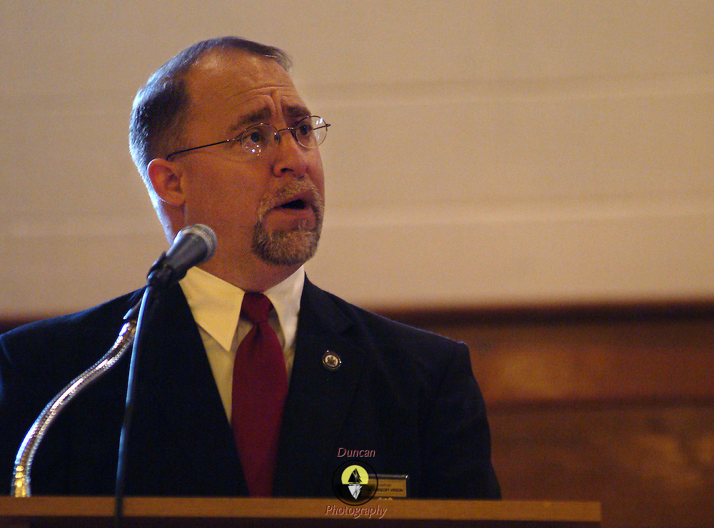 """BATH, Maine -- 12 /16/ 06 -- The Reverend Gregory Vinson of Bath presided over the Funeral for Bath City Councilor and Fireman John C. """"Jack"""" Hart Jr. Rev. Vinson is the Chaplain for the Police and Fire Depts. Photo by Roger S. Duncan ."""