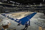 Crews set up the larger court configuration at Delmar Fieldhouse, November 1, 2016.