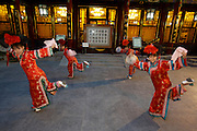 "Qiongdao (Jade Island) in Beihai Lake. Fangshan Imperial Food Restaurant. Waitresses dressed ""imperial style"" welcoming guests with a classic dance at the courtyard."