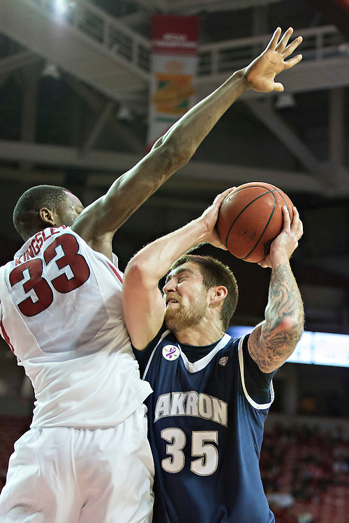 FAYETTEVILLE, AR - NOVEMBER 18:  Pat Forsythe #35 of the Akron Zips tries to go up for a shot and is fouled by Moses Kingsley #33 of the Arkansas Razorbacks at Bud Walton Arena on November 18, 2015 in Fayetteville, Arkansas.  (Photo by Wesley Hitt/Getty Images) *** Local Caption *** Pat Forsythe; Moses Kingsley