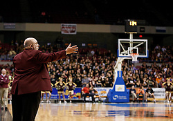 Wheeling Central Head Coach Mel Stephens tries to direct his team towards the other direction during a semi final round game at the Charleston Civic Center.