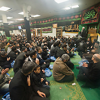 LONDON, ENGLAND - DECEMBER 27: Shia Muslim worshippers prey inside Holland Park Mosque after the Ashura Procession on December 27, 2009 in London, England. Ashura is a 10 day period of mourning for Imam Hussein, the seven-century grandson of Prophet Mohammad who was killed in a battle in Karbala in Iraq, in 680 AD.  (Photo by Marco Secchi/Getty Images)