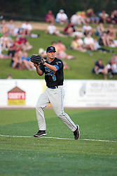 "1 June 2010: Mike Sullivan pulls in a fly ball for an out. The Windy City Thunderbolts are the opponents for the first home game in the history of the Normal Cornbelters in the new stadium coined the ""Corn Crib"" built on the campus of Heartland Community College in Normal Illinois."