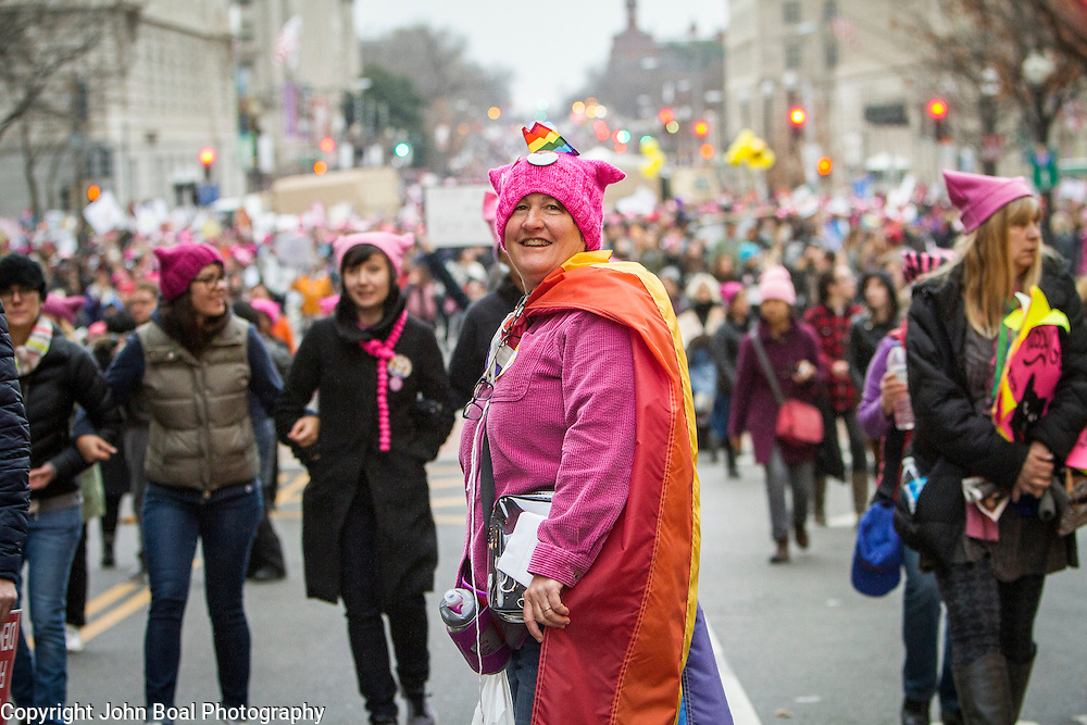 "Phred Huber, traveled from Atlanta to attend the Women's March on Washington where an anticipated 200,000 people turned into an estimated 500,000 to 1 million people, on Saturday, January 21, 2017.  When asked about her hopes for the next four years, she said, ""...I hope we don't cede any ground...We were on a really great path [during Obama's Presidency]...people need to realize that we are already great...I hope people realize there are facts...""  John Boal Photography"