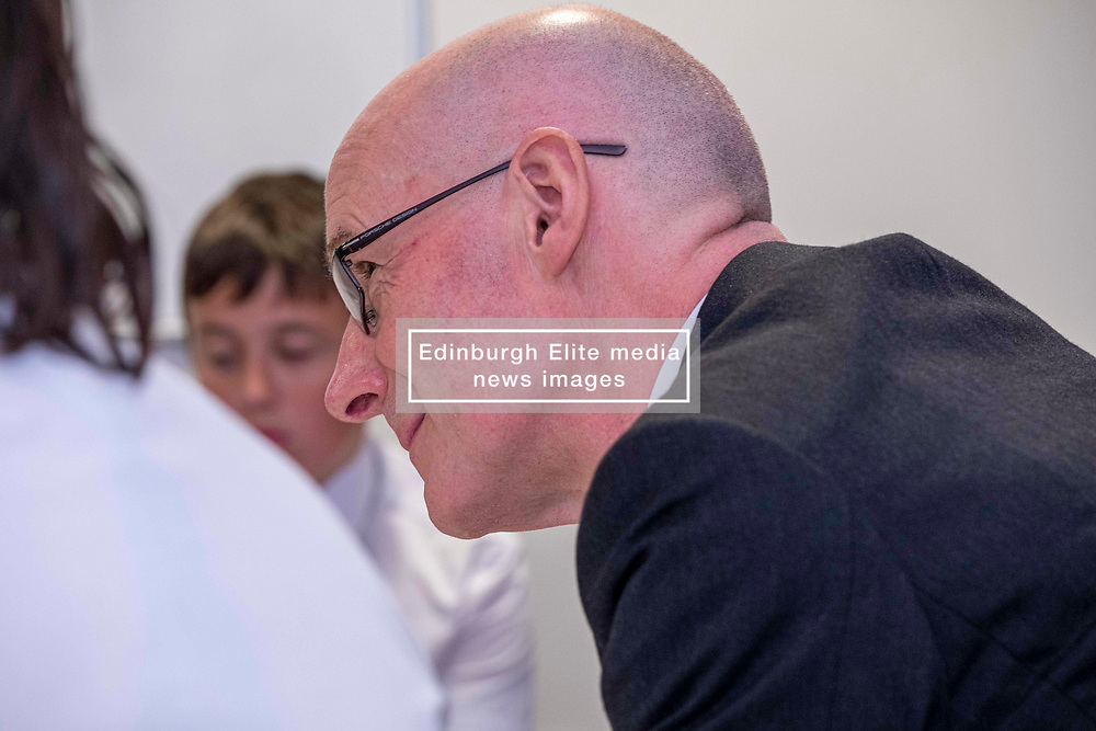 Pictured: John Swinney met students and parents in the Family Engagement Room<br /><br />The Deputy First Minister visited Holy Rood High School in Edinburgh today to meet parents and pupils before announcing GBP50 million funding for improving attainment.  The results of a survey of headteachers were also published during the Deputy First Minister's visit.<br /><br /> Ger Harley   EEm 30 May 2019